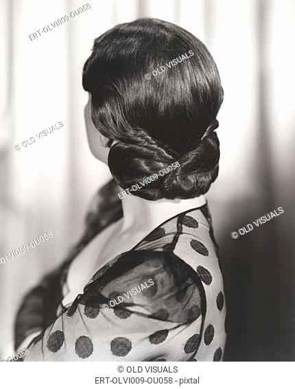 Rear view of woman's 1940s hairstyle