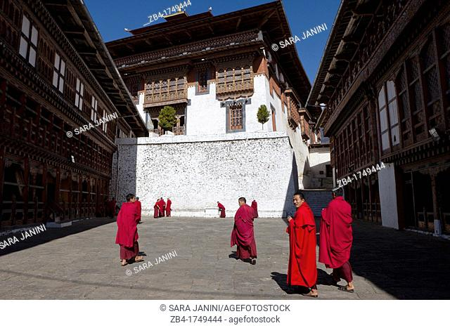A group of monks in the patio of Trongsa Dzong, Trongsa, Bhutan, Asia