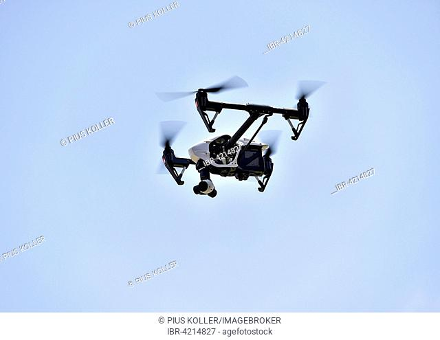 Drone in flight, carrying a film camera