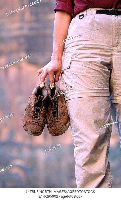 Hiker with muddy boots. Utah, USA