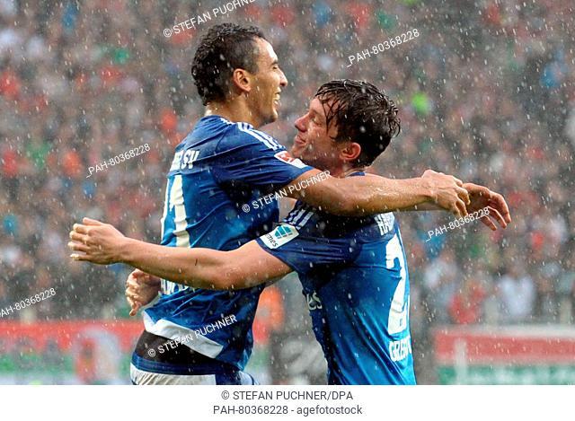 Nabil Bahoui (l) and Michael Gregoritsch of Hamburg celebrate the score 1:2 during the German Bundesliga soccer match between FC Augsburg and Hamburger SV at...