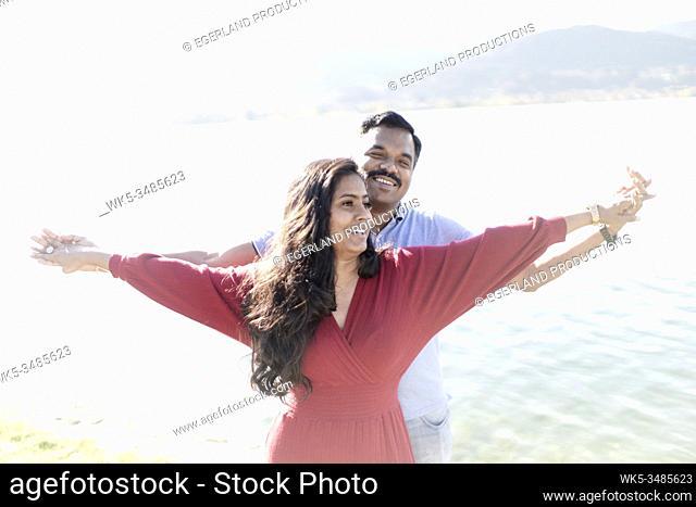 Indian couple feeling free. Tegernsee, Bavaria, Germany