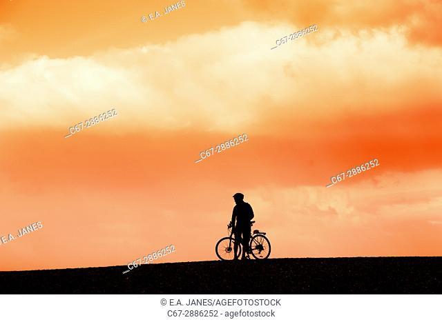Mountain biker on Cley beach Norfolk