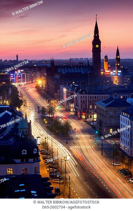 Denmark, Zealand, Copenhagen, elevated city view along H. C. Andersen Boulevard towards town hall, dusk