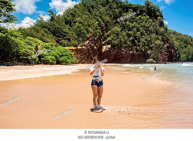 Woman on beach, Waianapanapa State Park, Maui, Hawaii