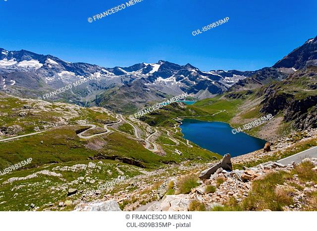 Scenic view of alps and lake, Colle del Nivolet, Piedmont, Italy