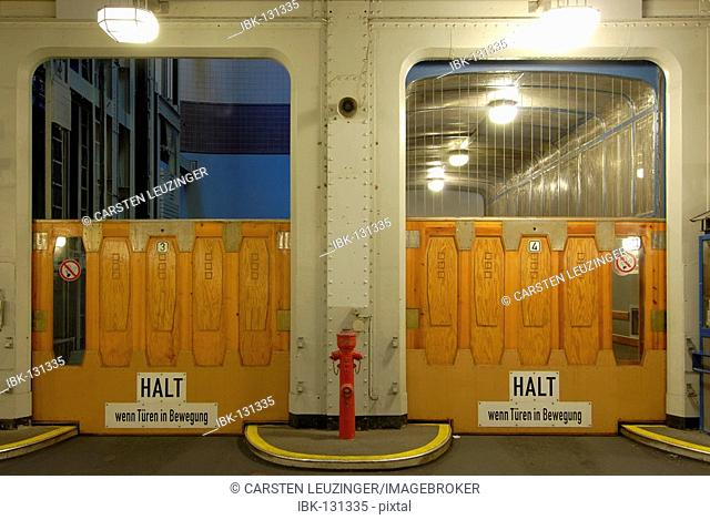 Elevater entraces in the old Elbtunnel at Hamburg Harbour, Hamburg, Germany
