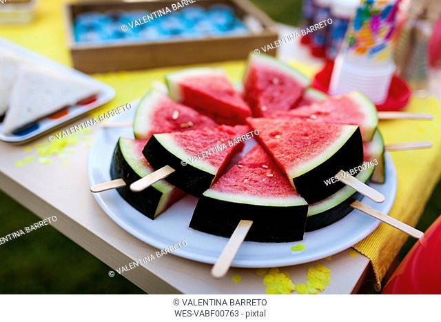 Birthday table with watermelon lollipops