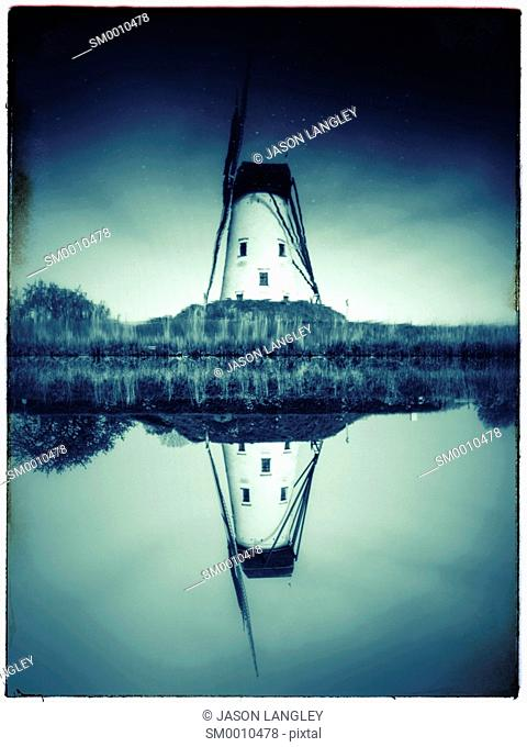 Windmill and reflection on canal, Damme, West-Flanders, Belgium