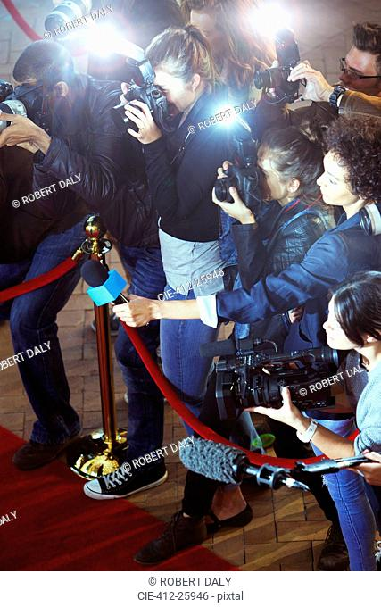 Paparazzi photographers and reporters at red carpet event
