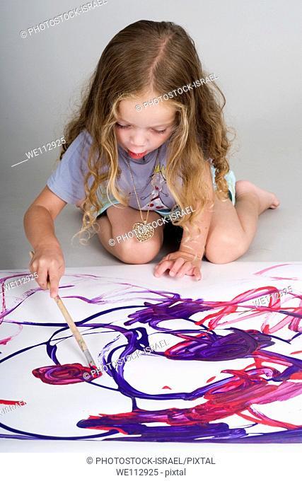 girl of three paints
