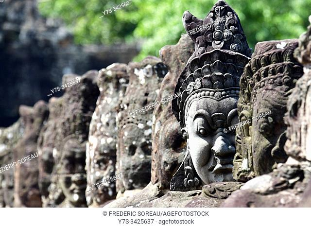 South Gate statues in Angkor archaelogical area in Siem Reap, Cambodia, South Esat Asia
