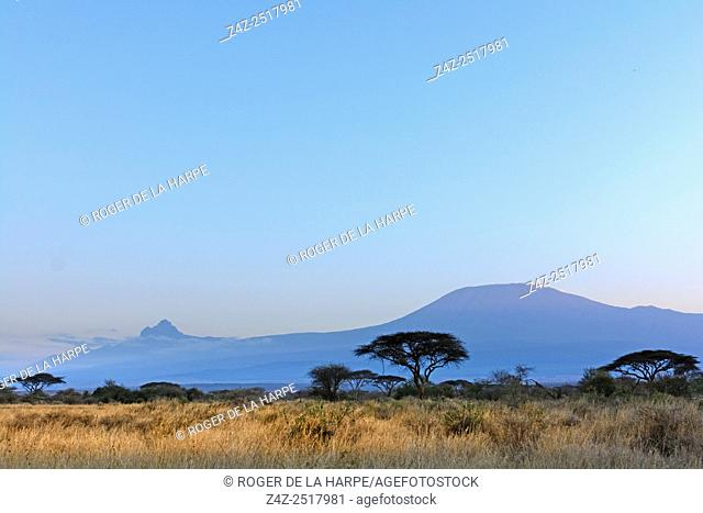 Mount (Mt) Kilimanjaro and Mount (MT) Mawenzi (in Tanzania) on the left from Satao Elerai Conservancy. Near Amboseli National Park. Kenya