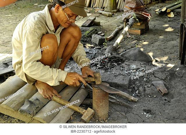 Man forging knives, Can Tho, Mekong Delta, Vietnam, Southeast Asia, Asia