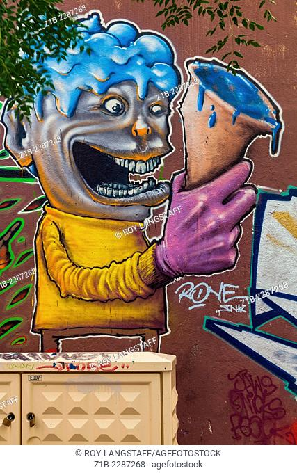 Street art of a person with a blue ice cream in the Panier district of Marseille