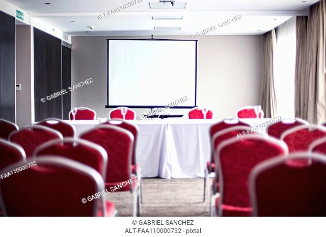 Empty conference room with projection screen
