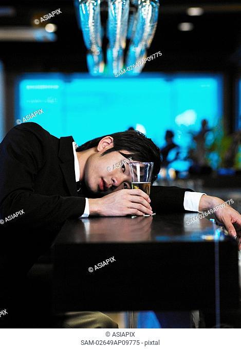 man relaxing at bar