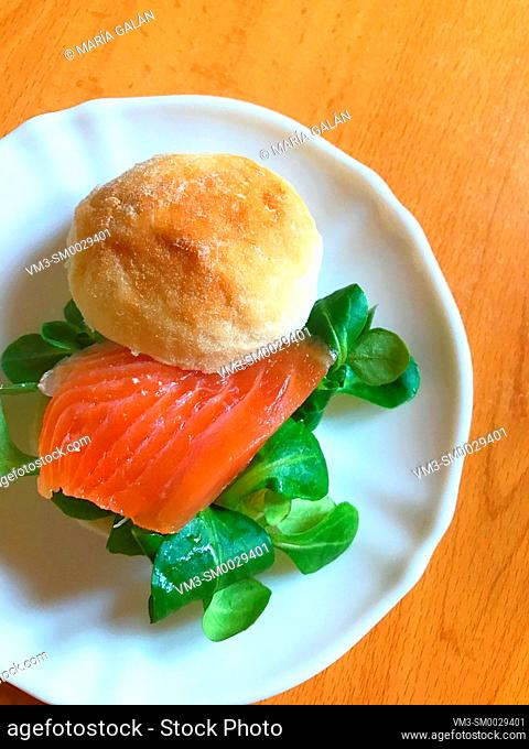 Smoked salmon with watercress on bread. View from above