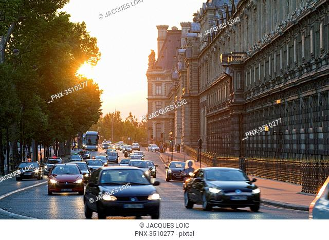 France, Paris, Quai Francois Mitterrand along the southern wing of the Louvre museum, evening traffic
