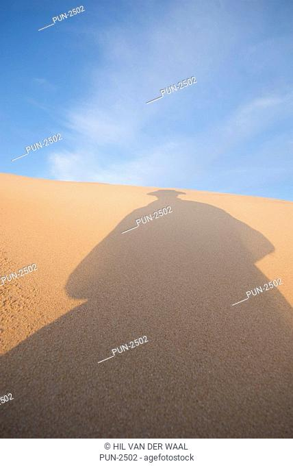 Man silhouette on sand