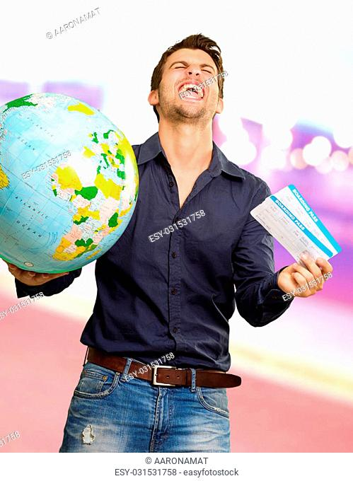 Young Man Holding Globe And Boarding Pass Screaming, Outdoor