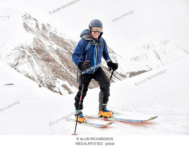 Georgia, Caucasus, Gudauri, confident man on a ski tour