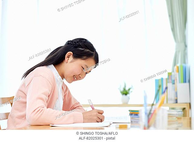 Japanese kid studying at home