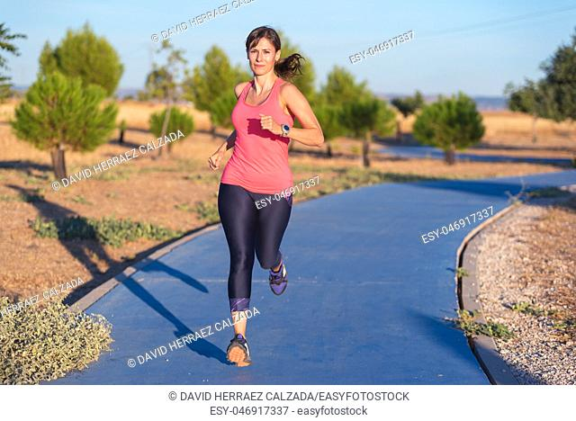 Fitness woman running in the park. Healthy lifestyle