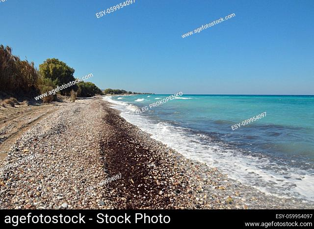 Panorama of the beach of the Aegean Sea in the village of Theologos on a the island of Rhodes in Greece