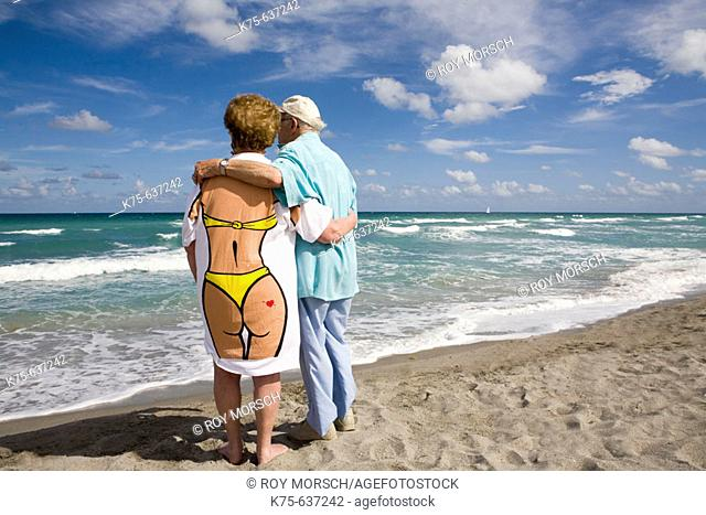 Senior couple hugging, wife wearing fun tee shirt
