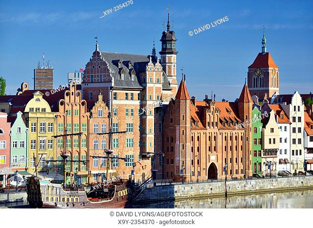 Gdansk Poland. Old Town centre. Dlugie Pobrzeze and Mariacka Gate frontage on the Motlawa River tourist area. Summer morning
