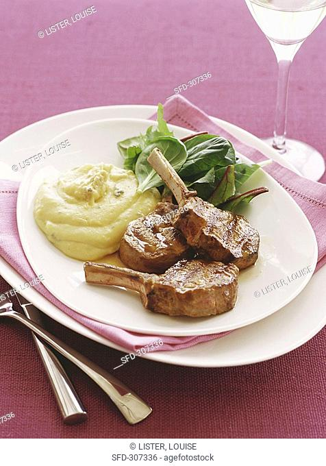 Lamb cutlets with polenta and cheese puree