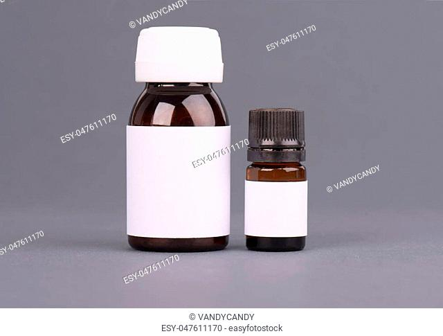 Blank big and medium size medicine white plastic packaging bottles for cosmetics, vitamins, pills or capsules