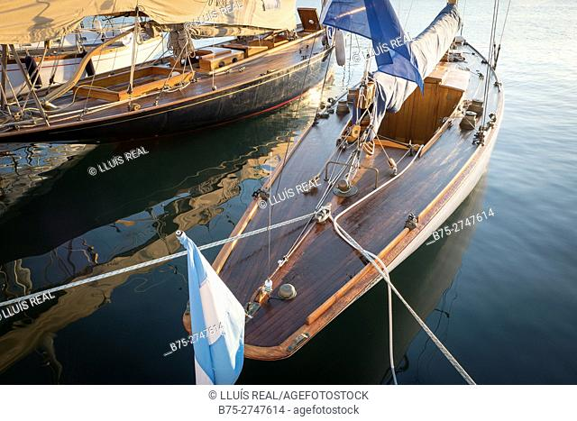 Moored vintage sailboats in the early morning. Port of Mahó, Minorca, Balearic Islands, Spain