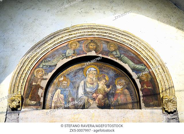 Fresco depictoing the virgin Mary with Child and St Peter and Sant'Agostino in the Collegiata di Santa Maria Assunta - Sermoneta, Italy