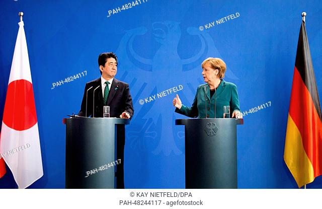 German Chancellor Angela Merkel (R) holds a press conference with the Japanese Prime Minister Shinzo Abe at theFederal Chancellery in Berlin,Germany