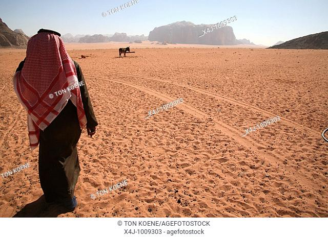 A Bedouin man walks in the desert  The Bedouins have lived for thousands of years in the desert around Wadi Rum