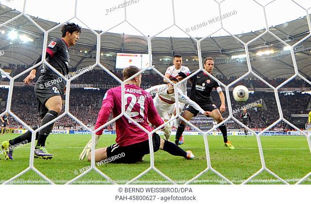 Stuttgart's Mohammed Abdellaoue (C) scores the 1-0 goal during the German Bundesliga soccer match between VfB Stuttgart and FSV Mainz 05 at the Mercedes-Benz...