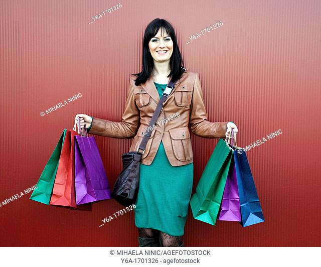 Young woman outdoors with shopping bags