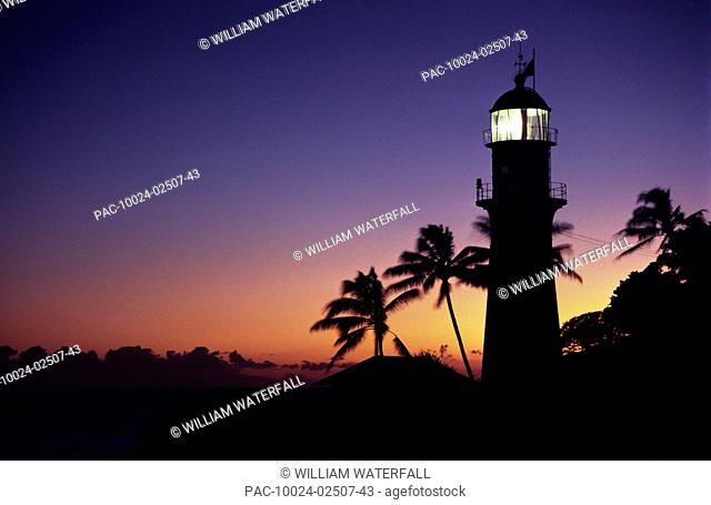 Hawaii, Oahu, Diamond Head Lighthouse silhouetted at sunset