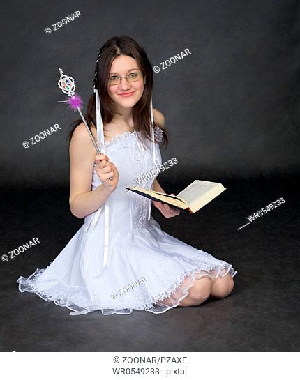 Girl - the magician with the book