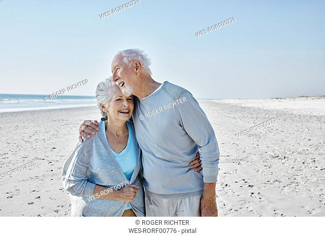 Happy senior couple on the beach
