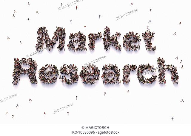 Overhead view of people forming words market research