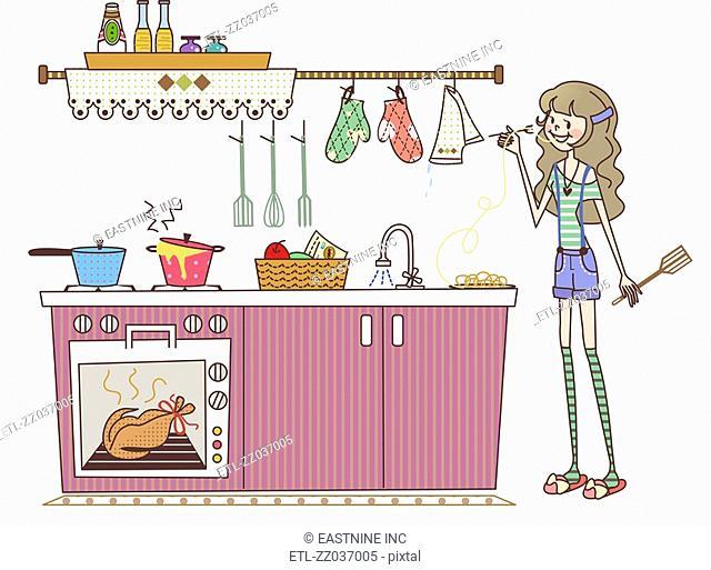 Woman tasting food in a domestic kitchen