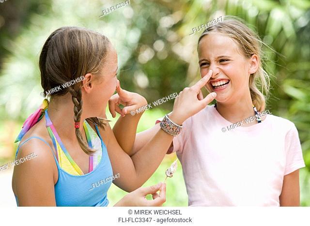 Two girls being playful, Sarasota, Florida, USA
