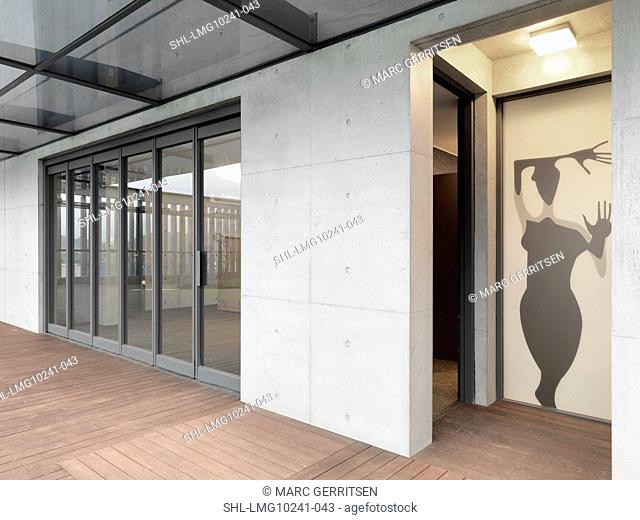 Silhouette of person on door in modern building