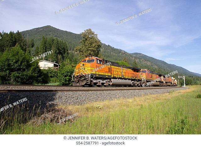 A BNSF train running on the Montana Rail Link line near Hope, north Idaho, USA
