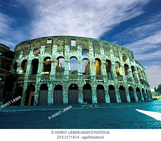 The Colosseum with clouds and two legionnaires in the foreground, Rome, Italy