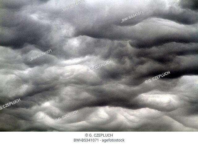 turbulence of grey cumulus clouds, Germany