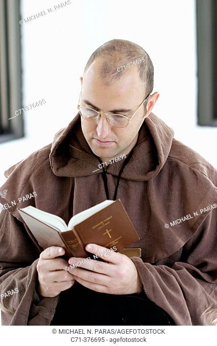 Monk. Priest reading Bible